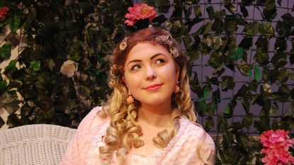 """Cecily Cardew, played by Julia Creutzer, dreams about her love, Earnest, in the Carroll Community College production of """"The Importance of Being Earnest."""""""