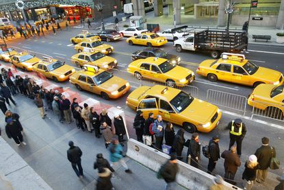 Morning rush hour commuters line up for cabs outside Grand Central Station in 2005. Uber cars, often black sedans that can be summoned with smartphone apps, now outnumber the yellow taxis that city riders have hailed for generations.