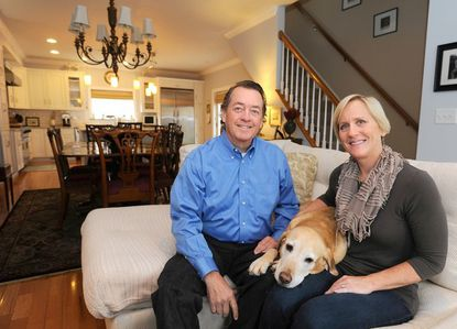 Richard and Key-Key von Lange and their yellow lab, Tiller, in their Federal Hill dream home.