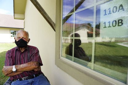 Seventy-year-old Jacobo Garcia visits his wife of 54 years Aurora Garcia, Tuesday, Aug. 25, 2020, at her bedside window just to see her smile at Fox Hollow Post Acute Nursing Home in Brownsville, Texas. Jacobo visits Aurora everyday amid the COVID-19 pandemic. (Miguel Roberts/AP)