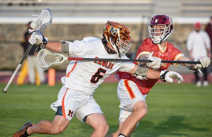 McDonogh's Hugh Brown (6) tries to get past Calvert Hall's Aden Johnson (7). Calvert Hall boys lacrosse travels to McDonogh for a game on Friday, April 23, 2021.