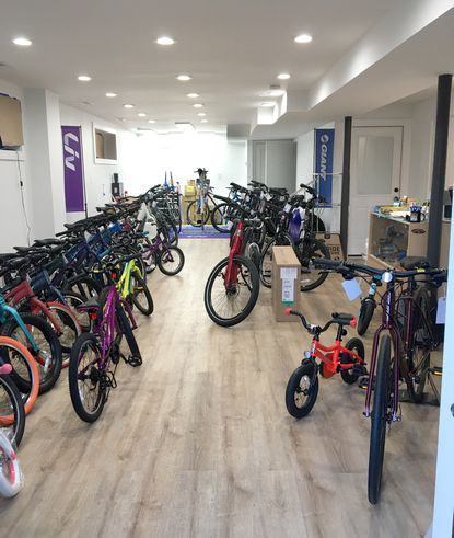 Setting up the spacious new interior of Pedal Fun Cycles in Towson, with inventory ready for spring bikers of all ages.