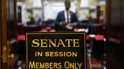 A sign stands outside an entrance to the Maryland state Senate chamber on Jan. 9, 2019, in Annapolis.