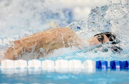 Michael Phelps powers through the water en route to his world record in the final of the 200-meter individual medley. Phelps swam the event in 1 minute, 54.80 seconds.