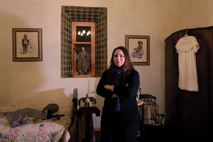 Paranormal investigator Nicole Strickland stands in a child's bedroom of the Rancho Buena Vista Adobe in Vista. She's a member of the San Diego Paranormal Research Society.