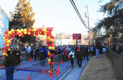 Runners line up on Fifth Street at the start of the 2013 Turkey Trot, which benefits Laurel Advocacy and Referral Services.