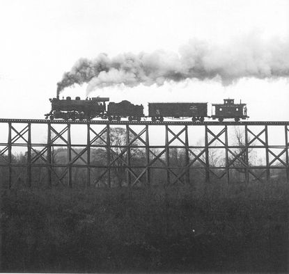 """One of the illustrations in """" Ma & Pa Remembered"""" is a photograph taken on Nov. 10, 1955, of Gross' Trestle No. 316, perhaps the most recognizable image ever taken of the Ma & Pa."""