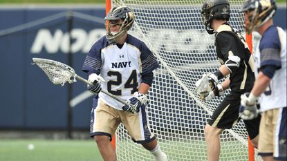 Navy's Ryan Kern makes a save during Saturday's game against Army West Point at Navy-Marine Corps Memorial Stadium.