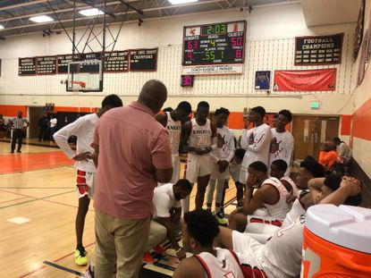 City huddles during their game against Woodlawn.
