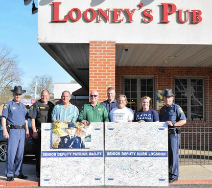 A daylong benefit concert at Looney's Pub raised $140,000 for the Harford County Deputy Sheriff Benevolent Fund. A check was presented two years ago to the Harford County Sheriff's Office and the benevolent fund. (Handout/Harford County Sheriff's Office).