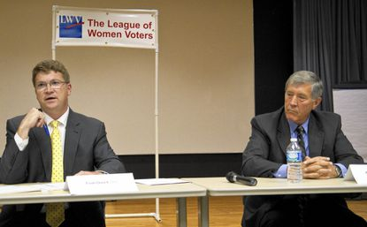 First District Councilman Tom Quirk, left, and his Republican opponent Al Nalley explain their views during a forum Wednesday, Oct. 1, at the Catonsville Library.