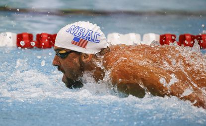 Olympic medalist Michael Phelps swims to victory in the championship heat of the men's 100-meter butterfly at the Bulldog Grand Slam swimming meet.