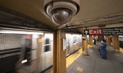 In this Oct. 7, 2020, file photo, a video surveillance camera is installed on the ceiling above a subway platform in the Court Street station in the Brooklyn borough of New York. State lawmakers across the U.S. are reconsidering the tradeoffs of facial recognition technology amid civil rights and racial bias concerns. (AP Photo/Mark Lennihan, File)