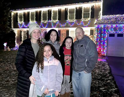 The Trivett family stands in front of their house on Galewood Road in the Springlake community of Lutherville Timonium. The family keeps adding more Christmas lights to spotlight the season, with the total now exceeding 15,000.