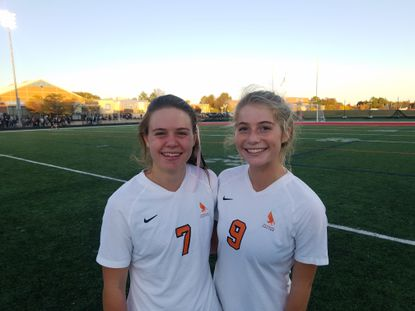 McDonogh's Baylee DeSmit, left, and Kemper Robinson teamed to produce the only goal in the Eagles' victory over top-ranked Archbishop Spalding.