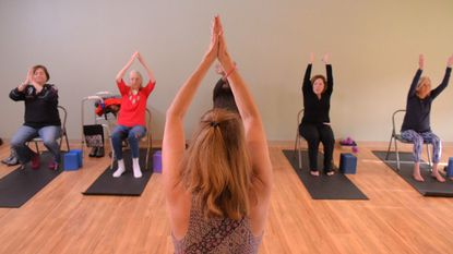 Yoga instructor and researcher Catherine Rees offers a free chair-based class for people with Alzheimer's disease and their caretakers at the Yoga Center of Columbia.