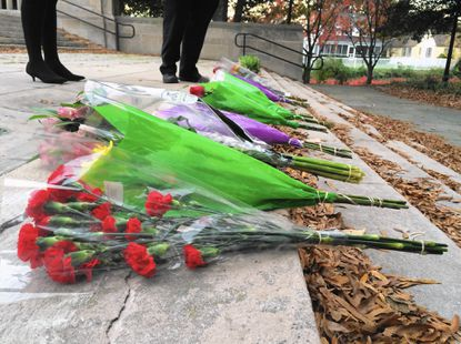 Flowers placed on the steps of the World War II Memorial in Annapolis following a vigil for the victims of recent terror attacks held by the Anne Arundel County Muslim Council.
