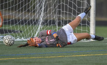 Centennial goalie Ashley Bilger, pictured here making a diving stop in a game earlier this season, has 65 saves for the Eagles this season.
