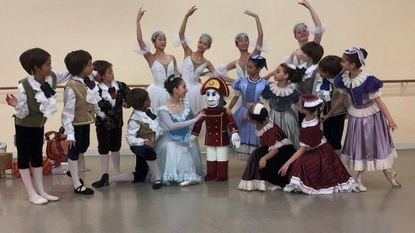 """Cast members of L'Etoile, The Classical Ballet Theatre of Maryland 's production of """"The Nutcracker,"""" pose with the beloved character."""