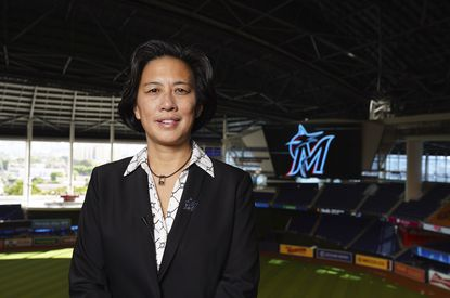 In this photo provided by the Miami Marlins, new Miami Marlins general manager Kim Ng poses for a photo at Marlins Park stadium before being introduced during a virtual news conference, Monday, Nov. 16, 2020, in Miami.