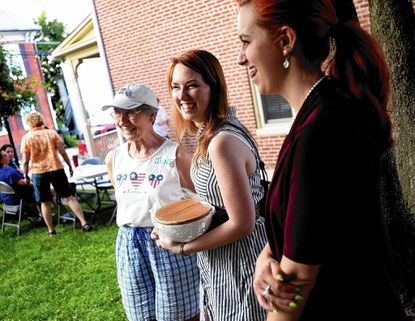 June Horner, left, Jennifer Bock, center, and Krista Regester share a laugh as Sunday's Westminster-Carroll County PFLAG Annual BBQ wraps up at St. Paul's United Church of Christ in Westminster August 17, 2014.