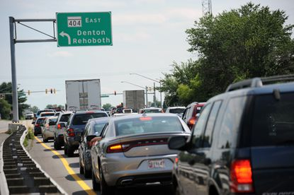 Traffic on Route 50 south waits to turn onto Route 404 heading east. Talbot and Caroline Counties got $160 million to widen Route 404.