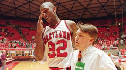 Maryland's Joe Smith and assistant sports information director Chuck Walsh leave the court after the Terps' NCAA tournament victory over Texas in 1995.