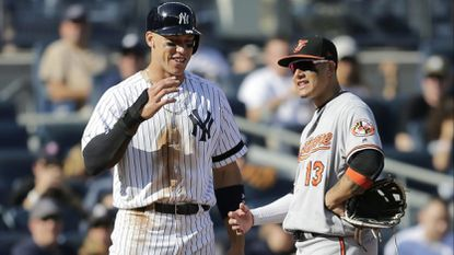The New York Yankees' Aaron Judge, left, talks with former Orioles third baseman Manny Machado during the eighth inning of a game at Yankee Stadium, Sunday, Sept. 17, 2017, in New York.