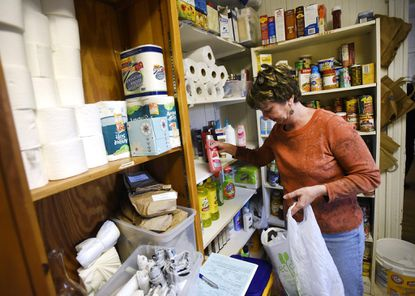 Volunteer Donna Devilbiss picks out items to fulfill a list of needs for a client in the blessings closet at the Shepherd's Staff in Westminster Thursday, Nov. 17, 2016.