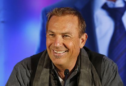 """Actor Kevin Costner smiles during a news conference for the movie """"Draft Day"""" in New York on Friday, Jan. 31, 2014."""