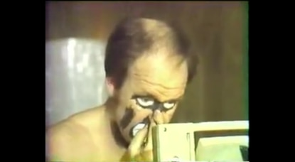 A screenshot of former police officer Bobby Berger applying his makeup during an undated TV news profile found on YouTube.