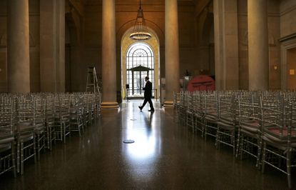 Security guard Leif Mobley monitors the Fox Court Lobby at the Baltimore Museum of Art as it is prepared for a celebratory gala. (Cassidy Johnson/Baltimore Sun).