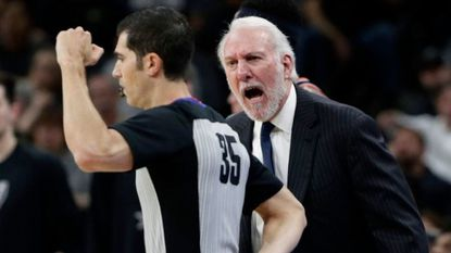 San Antonio Spurs head coach Gregg Popovich, right, argues a call with referee Steve Anderson (35) during the first half of an NBA basketball game against the Portland Trail Blazers, in San Antonio.