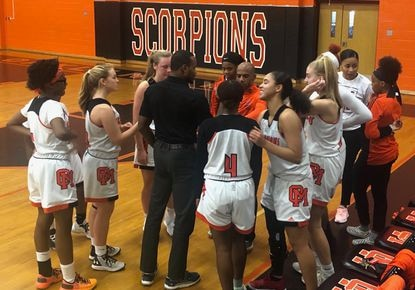 The Oakland Mills girls basketball team talks during a timeout of its game against Milford Mill on Friday, Dec. 27, 2019.