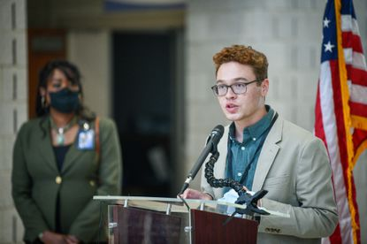 """Christian Thomas, the student member of the Baltimore County Board of Education speaks at a press conference on efforts to increase Covid-19 vaccination rates among students in Baltimore County. At a meeting this summer, he chided the 12-member board for being """"broken."""""""