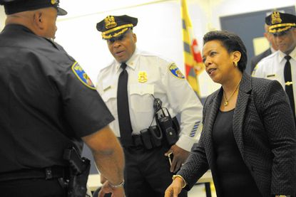 U.S. Atty. Gen. Loretta Lynch meets with Baltimore police officers this month.