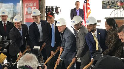 City officials and Under Armour executives during a ceremonial groundbreaking for the Port Covington redevelopment project in May 2019.