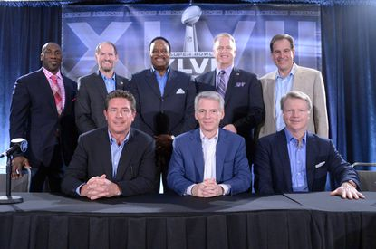 CBS Sports' broadcast team poses at a Super Bowl XLVII news conference. Front row: Dan Marino (left), Sean McManus (center) and Phil Simms. Back row (from left) Shannon Sharpe and Bill Cowher and James Brown and Boomer Esiason and Jim Nantz.