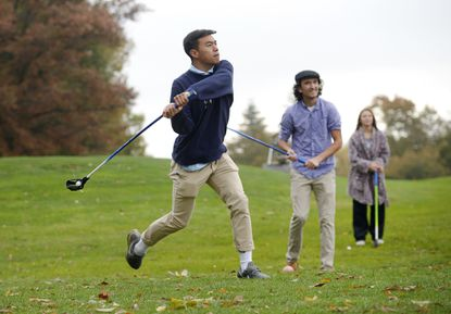 Century senior Matt Pham tees off while playing FlingGolf with classmate Jules Centofanti and Madison Plitt, a junior, at the McDaniel College Golf Course in Westminster Monday, October 21, 2019. FlingGolf is a new sport being introduced into Carroll County Public Schools high school PE curriculum.