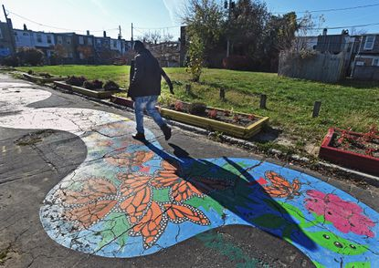Baltimore, MD -- 11/25/15 -- A community park at the 600 block of North Port Street that is operated under the community land trust. Community groups in Baltimore City are exploring the idea of community land trusts to take over vacant lots or homes in their community.