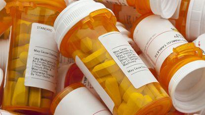 Several prescription pill bottles.