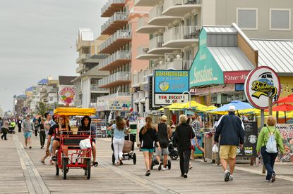 The boardwalk scene near 10th Street in Ocean City just before Memorial Day weekend where businesses face a hiring crunch with fewer job applicants at the same time that there is an expected increase in tourism, the product of post-COVID-19 pent-up demand for travel. May 25, 2021. (Amy Davis/Baltimore Sun).