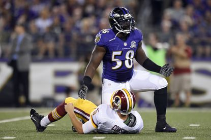 Ravens' Elvis Dumervil says he's more of a pro than when he played for Denver