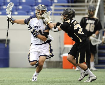 Army's Luke Poulos checks Navy's Casey Rees during Friday afternoon's Patriot League Semifinals against Army West Point held at the Navy Marine Corps Memorial Stadium.
