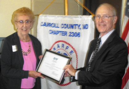 """Frances Kane, left, and Bill Gray show the certificate she received from CareFirst designating her as the """"Annuitant of the Year"""" for the Carroll County Chapter, National Active and Retired Federal Employees Association."""