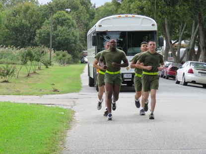 """Over 70 Marines ran through West Point just before noon on Thursday in honor of Marine Lt. Gen. Lewis B. """"Chesty"""" Puller."""