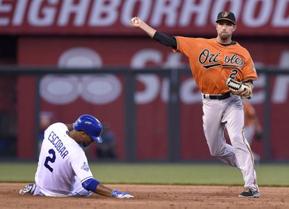 Baltimore Orioles shortstop J.J. Hardy forces the Kansas City Royals' Alcides Escobar (2) out at second and completes the double play on Mike Moustakas to end the fifth inning on Saturday, April 23, 2016, at Kauffman Stadium in Kansas City, Mo.