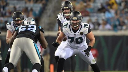 Offensive lineman Luke Bowanko (70), then with the Jaguars, blocks against Panthers defensive tackle Gabriel Mass (62) during the second half of a preseason game Thursday, Aug. 24, 2017, in Jacksonville, Fla.