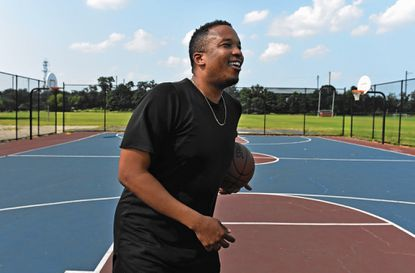 Writer D. Watkins, a self-admitted former drug dealer turned national commentator, plays basketball last September at a East Baltimore neighborhood court where he played growing up.