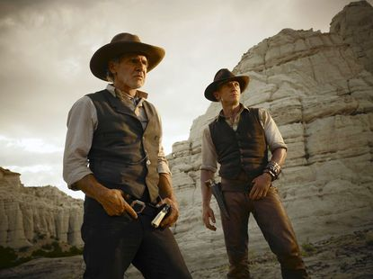 """Harrison Ford as the iron-fisted Colonel Dolarhyde joins with and Daniel Craig as a stranger with no memory of his past in the genre-mixing """"Cowboys & Aliens,"""" now playing at area theaters."""